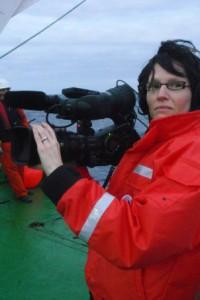 Dena films on stern of ship